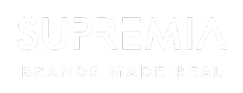 Supremia logo Baseline White
